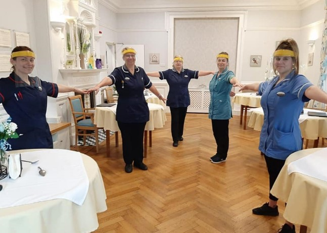 The team at Ashview Nursing Home showing off their new masks whilst socially distancing